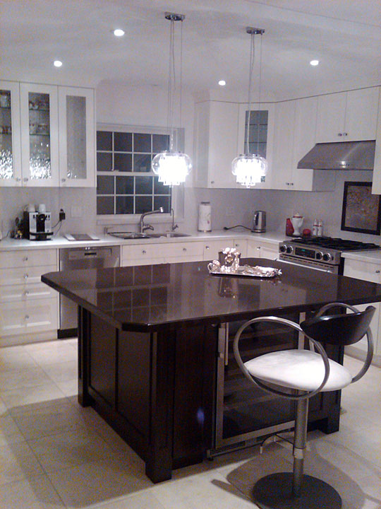 Larger Image - This custom kitchen refacing project was inspired by AWARD and our customer.  We refaced 70% of the kitchen, added a few cabinets, and included a convenient island at a fraction of the price of the competition.