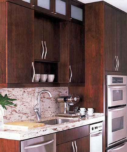 Larger Image - We set back the upper cabinets to provide a focal point for the shelf over the sink.