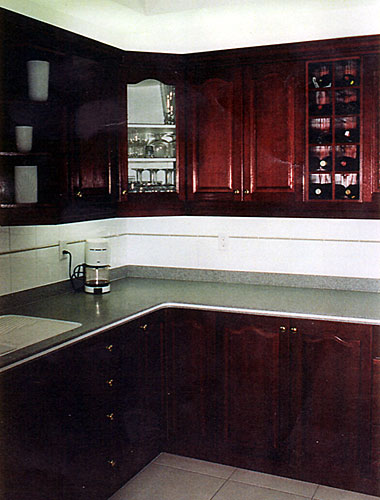 Larger Image - Another simple kitchen refacing that adds a stunning statement to your kitchen.