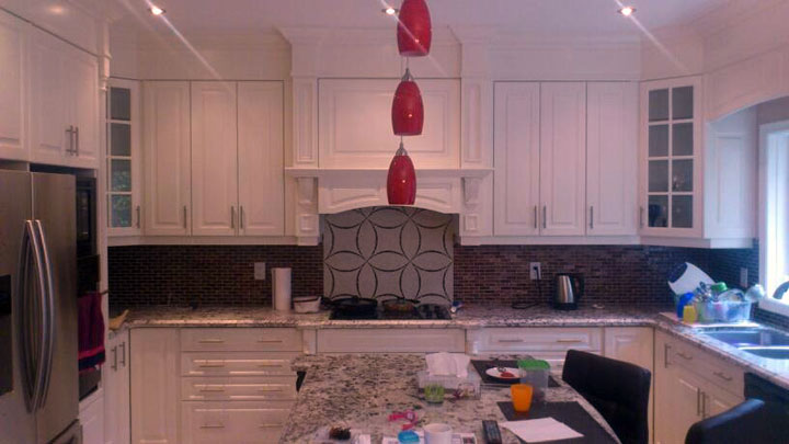 Larger Image - A custom kitchen refacing project with a serving area that does not interfere with cooking and food preparation.