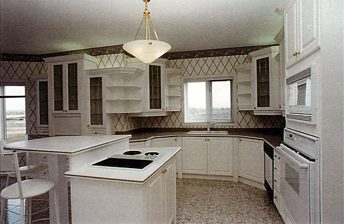 Larger Image - This kitchen was damaged by a fire.  We were able to reface the cabinets without replacing them, saving thousands of dollars as a result.