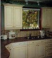 We take pride in installing a variety of shapes, configurations, and types of crown mouldings and valances while refacing your kitchen.
