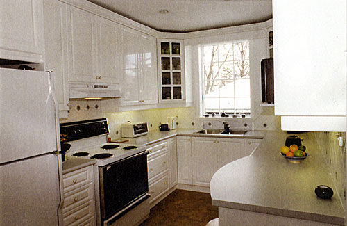 Larger Image - This kitchen was dark and poorly lit before we refaced it.