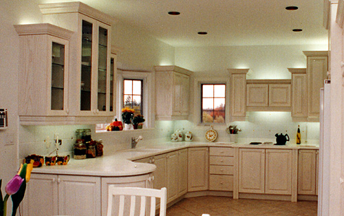 Larger Image - We replaced the lower cabinets in this kitchen, and refaced all of the other kitchen cabinets.