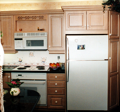 Larger Image - We can introduce custom concepts and details to your kitchen to enhance its beauty and function, such as crown moulding, inset cabinets, and microwave shelves.