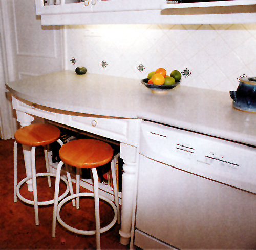 Larger Image - We added an eating / study area to this kitchen for the children of the family.