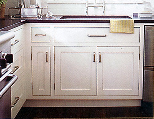 Larger Image - Simple refacing with new doors and handles turn this dark, old framed cabinet into this wonderful looking cabinet.