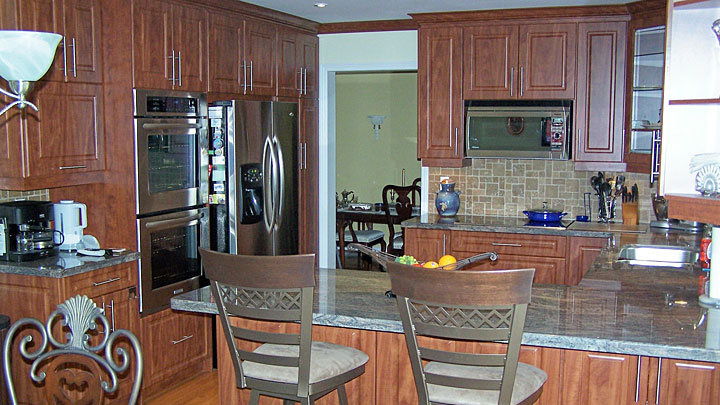 "Larger Image - Can you tell which cabinets were added when this kitchen was refaced.? Click the ""More Info"" link below to find out."